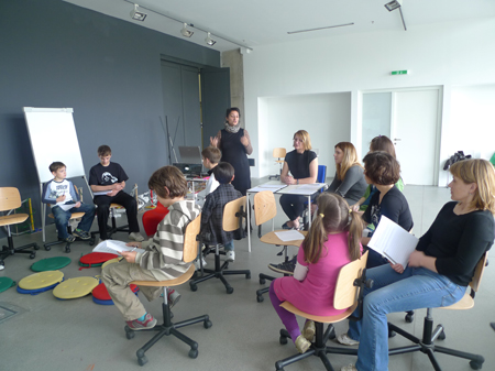 Lecture for children by Ivana Armanini for the project Toboggan - the wheel of the future at MOCA, ZG.
